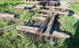 The sleeper railway. this is old wood. Old railway sleeper with iron bolts Royalty Free Stock Photos