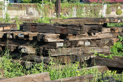 The sleeper railway. this is old wood. Old railway sleeper with iron bolts Royalty Free Stock Photography