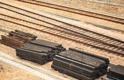 Sleeper and tracks. Used wooden sleeper and metal tracks at railway Stock Photo