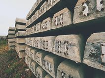 Sleepers production. Concrete casting and assembly.  New concrete railway ties stored Stock Photos