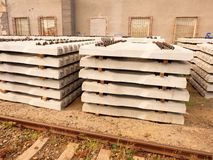 Sleepers stock in railway depot. Concrete railway ties stored for reconstruction Stock Images