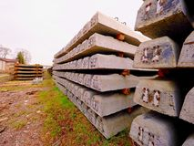 Sleepers stock in railway depot. New concrete railway ties stored for reconstruction of old railway station. Royalty Free Stock Photo