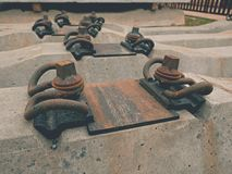 Sleepers stock in railway depot. New concrete railway ties stored for reconstruction of old railway station. Royalty Free Stock Image