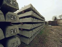 Sleepers stock in railway depot. New concrete railway ties stored for reconstruction of old railway station. Stock Images