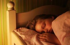 Sleeping. Little girl is sleeping well in her bed Stock Image