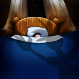 Sleeping. A small child sleeping and tucked into a large bed.  The shadow of the boogie man or monster falls across the bed. Concept for a childrens story book Stock Images