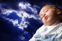 Sleeping. A child sleeping in the background sky Stock Photos