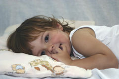 Almost sleeping. Little child lying in bed Stock Photography