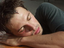 Sleeping. Traing man finished and exhausted Stock Images