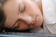 Sleeping. Beautiful women sleeping on keyboard Royalty Free Stock Images