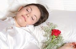 Sleeping. Women sleeping with rose during valentine days Stock Image