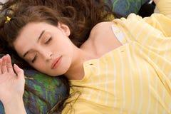Sleeping. Beautiful young woman in yellow pajamas sleeping Royalty Free Stock Images