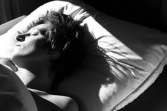 Sleeping. A sleeping woman with the morning light shining on her face Royalty Free Stock Image
