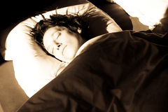 Sleeping. A sleeping woman with the morning light shining on her face Stock Photos