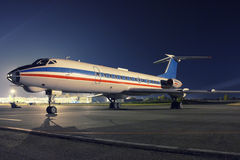 Sleeping airplane in the night. Apron Stock Photos