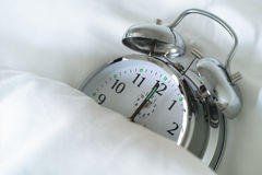 Sleeping alarm clock Stock Images