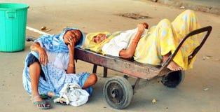Sleeping Alongside the Road. Poor street sweeper woman Sleeping Alongside the Road in India royalty free stock photography