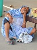 Sleeping Alongside the Road. Poor working woman Sleeping Alongside the Road in India stock photography