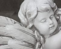 Sleeping angel statue. Memorial angel in white stone Stock Images
