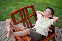 Sleeping on the armchair boy Royalty Free Stock Photo