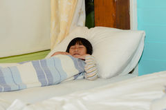 Sleeping Asian boy on bed. Royalty Free Stock Images