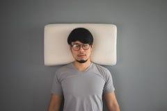 Sleeping Asian man. Royalty Free Stock Images