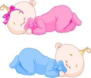 Sleeping Babies. Two charming little twins sleep in pajamas Royalty Free Stock Image