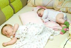 Sleeping babies. Two cute babies sleeping in one bed Royalty Free Stock Photo