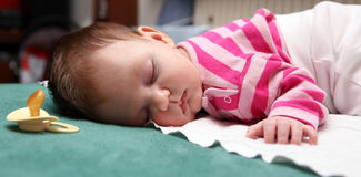 Sleeping baby 06. A sleeping new born baby and a pacifier Royalty Free Stock Photo