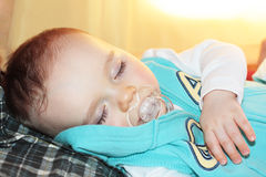 Sleeping baby. Portrait of a little baby sleeping with one hand over his chest Stock Photography
