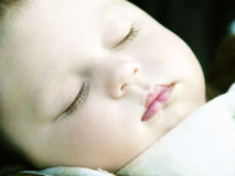 Sleeping baby. Close-up portrait of a cute sleeping baby Royalty Free Stock Photography