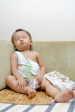 Sleeping baby. A Chinese baby is sleeping on the sofa. It is so cute Stock Photo