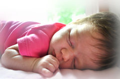 Sleeping Baby. Baby sleeping on belly in color Stock Photo