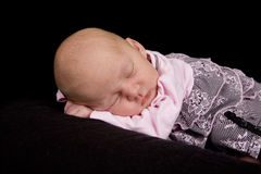 Sleeping Baby. A sleeping baby on a black background stock photos