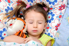 Sleeping baby. Baby sleeps in the bed Royalty Free Stock Photography