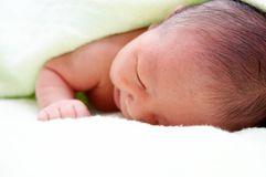 Sleeping baby. A sleeping newborn baby covered by towel, 7 days young Royalty Free Stock Image
