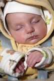 Sleeping baby. A sleeping new born baby in winter clothes Stock Photography