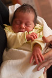 Sleeping baby. Newborn baby sleeping in mother hands Stock Photos