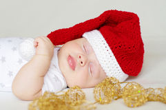Sleeping baby age of 2 months in a New Year's hat. Lovely sleeping baby age of 2 months in a New Year's hat stock photos