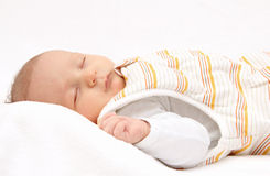 Sleeping baby on back in sleeping bag Royalty Free Stock Image