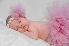 A Sleeping Baby Ballerina. Dressed in a pink tutu Stock Photography