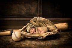 Sleeping baby in baseball glove