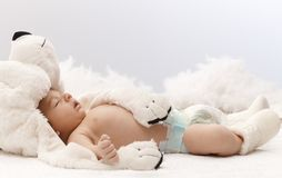 Sleeping baby with bear. Sleeping newborn baby with big bear hat royalty free stock images