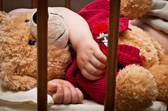 Sleeping baby with bear toy Royalty Free Stock Photo