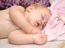 Sleeping baby. Beautiful baby sleeping with open mouth stock image