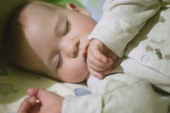 Sleeping baby in bed. Stock Photo