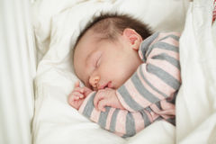 Sleeping baby in bed (up to 20 days) Stock Photo