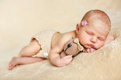 Sleeping baby on a beige background Stock Photos