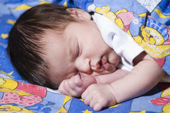 Sleeping baby blanketed Stock Photos