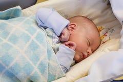 Sleeping baby boy. A baby boy asleep in bed Royalty Free Stock Photos